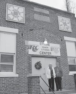 """Judith Vermillion (left) and Coleene Hart were in charge of having two quilt squares recently mounted to the front of the Ermine Senior Citizens Center. The quilt pictured to the left is called """"Feathered Star"""" and the other square is """"Star of the East."""" Vermillion painted the two 4 x 4 quilt squares and said she painted them in honor of all the quilters at the senior citizens center."""