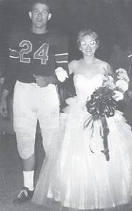 Jim Jones escorts 1955-56 Homecoming Queen Lona Lykins.
