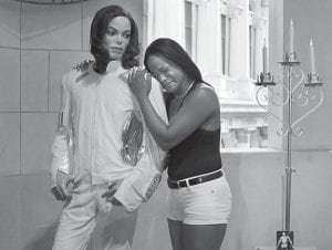 Shayla Ivy cries as she held a wax replica of Michael Jackson on June 25 outside of Madame Tussaud's Wax Museum at The Venetian Hotel and Casino in Las Vegas the day Jackson died. Jackson's stunning death was voted the top entertainment story of 2009 by newspaper and broadcast editors surveyed by The Associated Press. (AP Photo)