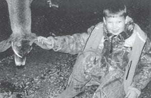 YOUNG HUNTER — Jake Bowling, the seven-year-old son of Marcus and Nikki Bowling of Madisonville, recently killed his first deer. He is a grandson of Wayne and Gaylen Bowling, and John and Earlene Williams.