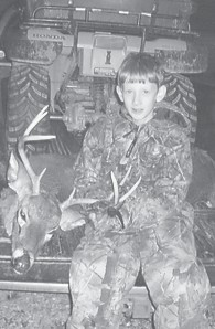 FIRST DEER — Jacob Dollarhide killed an eightpoint deer while hunting with his grandfather, Buddy Collins. Jacob is the son of Chris and Becky Dollarhide.
