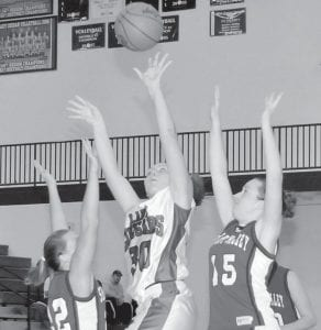 HANDS UP! — Letcher County Central's Shannon Bays split the Shelby Valley defense to fire up a shot in her 24- point performance, leading the Lady Cougars to a 68-35 win over the Lady Wildcats. (Photo by Chris Anderson)