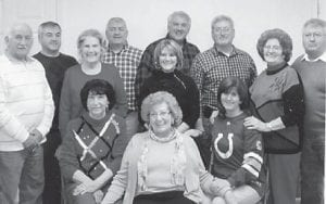 FAMILY GATHERING — Members of the Howard family met recently for a Christmas party. Among those attending was Jenetta Howard (first row, at left), the widow of Eddie Howard. Whitesburg correspondent Oma Hatton (second row, second from left), Jenetta Howard's sister-in-law, says the photo was requested by Anna Watkins of Florida.