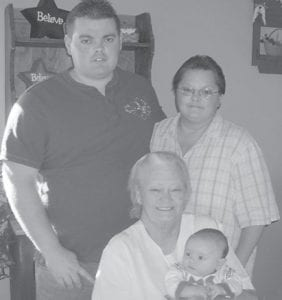 FOUR GENERATIONS — Logan Jaymes Couch, born Sept. 28, is surrounded by his father James Couch of Cram Creek, his grandmother Kathryn Patricia Ison of Paintsville, and his great-grandmother Froney Gaye McPeeks of Jenkins. He is also the first great-grandson of the late James Daniel Brock of Mayking.