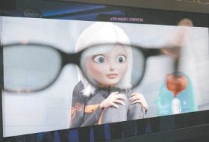 A character from the movie Monsters vs Aliens by Dreamworks is shown through 3D glasses at the Intel booth at the International Consumer Electronics Show (CES) in Las Vegas. (AP Photo)