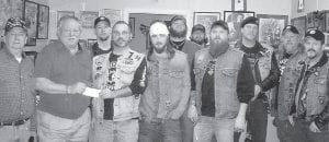 DONATION — Chairman Buddy Grubb and Secretary Darrell Holbrook of the Letcher County Veterans Center recently received a $300 dona tion for the S eventh Sons Motorcycle Club.