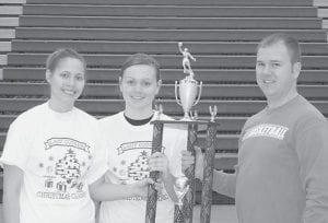 The Letcher County Central Lady Cougars won 14 straight games recently, including the championship of their own holiday tournament. Here, seniors Brittany Sexton and Shannon Bays were presented with the championship trophy by Whitesburg attorney Jamie Hatton, who sponsored the tourney as part of his candidacy for the office of Letcher County Attorney. Sexton is the newest member of the LCCHS 1,000 point club.