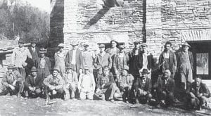 THE GRAHAM MEMORIAL PRESBYTERIAN CHURCH is thought to be the site of this old photograph. The only man identified for certain is Hop Gibson, the last man on the right. Others who may be pictured include a Day, a Johnson, and a Majority.
