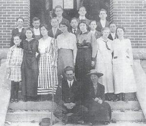 WHS FACULTY AND STUDENTS, 1914 — Pictured are (front row) Jerome Eastham, principal; Nancy Jane Huff , assistant; (second row) Grace Newman, Ora Day, Ida Mullins, Allie Fields, Polly Fields Eastham, Alpha Frazier, Edna Fugate, (third row) Astor Hays, Curtis Lewis, Harrison Gibson, Beckham Caudill, Charles Fugate, Herman Hale, (fourth row) Howard Fields, Henry Williams, and J.L. Hays.