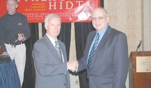 Frank Rapier, left, director of Appalachia HIDTA, congratulated Letcher County Sheriff Danny Webb after Webb's appointment to the agency's board of directors.