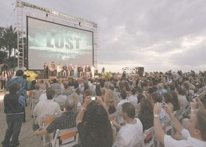Beachgoers are seen at the Lost premiere on Waikiki Beach in Honolulu. Lost, which is filmed in Hawaii, has returned to television for its sixth and final season. (AP Photo)