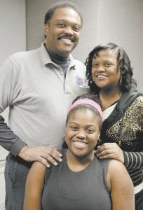 Paris Woods, center, mother, Dinah Woods and father Parris Woods posed for a portrait last week as they took part in their final session of a 20-month obesity prevention study at Rush University Medical Center in Chicago. (AP Photo)
