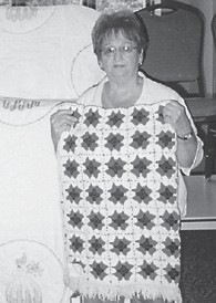SYBIL WHITAKER of Whitesburg made this afghan which was chosen grand champion of the Letcher County Extension Service exhibit during Mountain Heritage week. Her work has won 10 ribbons and includes quilts as well as afghans.