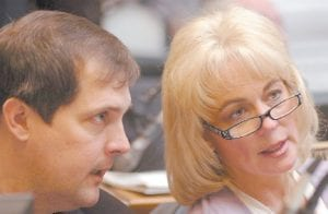 State Rep. Leslie Combs, right, spoke with Rep. Fitz Steele during a legislative session in Frankfort last week. Combs, a Democrat from Pikeville, represents the majority of Letcher County.