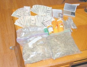 More than three pounds of processed marijuana, 200 pain pills and $2,500 in cash were seized on Feb. 16 from the home of Jerry Halcomb, 46, of 378 Valley Branch Road in Gordon.