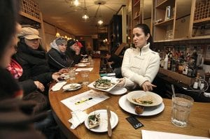 "Nikki Cascone, right, a contestant on the fourth season of cable television's ""Top Chef,"" meets with people attending ""In the Steps of a Top Chef "" with City Food Tours, in her New York restaurant 24 Prince. (AP Photo/Richard Drew)"