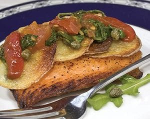 Potato-crusted salmon with tomato and arugula relish which has the king of fish topped with a tangy relish that is colorful as well as delicious. (AP Photo/Larry Crowe)