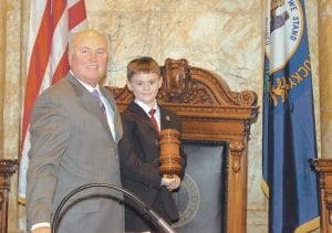 FUTURE LAWMAKER? — Zachary Hall of Whitesburg was page for the day on Monday for Kentucky State Senator Johnny Ray Turner, D-Drift, who represents Letcher County. Zach, 5, is in kindergarten at West Whitesburg Elementary School. He is the son of Brandee and Charles Hall of Whitesburg. Zach's grandmother, Eleanor Caudill, took him to Frankfort to spend the day with Senator Turner. (Photo by Mike Sunseri, LRC Public Information.)