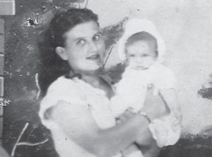 MARLOWE FRIEND — Nellie Banks, a former resident of Marlowe, is pictured holding one of her children. She now lives in Bloomington, Ind.