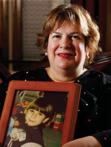 Joan Stavros Adler holds a photograph of her son Eric Stavros Adler in her home in Warren, N.J. Eric choked to death on a piece of hot dog nine years ago at age four. Now, some food makers including Oscar Mayer have added warning labels about choking, but not nearly enough, says Joan Stavros Adler. (AP Photo/Mel Evans)