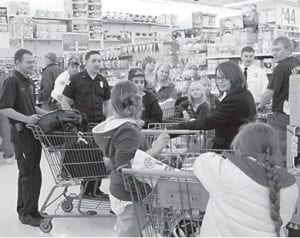 SHOPPING WITH A FIREFIGHTER — Members of the Jenkins Volunteer Fire Department and the Fire Corps took a group of children to 'shop with a firefighter' in December. After the shopping excursion, the children went to the firehouse where they enjoyed pizza.