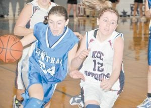 LEADING THE WAY — Letcher County Central's sharpshooting freshman Kelah Eldridge put on a show during the Lady Cougars' 66-57 win over Knott Central in the championship game of the Girls' 53rd District Tournament. Eldridge, who burned the nets for 37 points, is seen here driving the ball up the floor during a very physical game. Eldridge connected on five three-point field goals during the game and also hit 12 of 15 free throws she attempted. The Girls' 14th Regional Tournament opened this week in Whitesburg. On Tuesday night, Knott Central defeated Powell County, 65-61. Letcher Central will meet Breathitt County at 6:30 p.m. on Friday. (Photo by Chris Anderson)