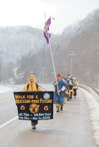 WALKING FOR A CAUSE — A group of activists against nuclear weapons and nuclear power walked in the snow from Pine Mountain on US 119 to Seco on Feb. 25 during a three-month walk called 'Footprints for Peace.' The group started their journey on Feb. 13 in Oak Ridge, Tenn. in front of the Y-12 National Security Complex, which stores nuclear materials. The walk will finish in May at the opening of the Nuclear Non-Proliferation Treaty Review Conference at the United Nations in New York City. (Photo by Sally Barto)