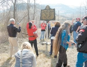 Several people who attended the March 9 ceremony in honor of those who died 34 years ago during the Scotia mine disaster took photos of the historical marker.