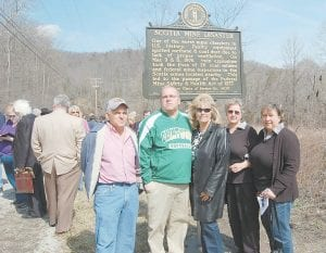 Family members of Dennis C. Boggs posed for a photograph in front of the marker. Boggs died in the first explosion on March 9, 1976. Pictured from left are Dennis C. Boggs's brother Everett Boggs, his son Dennis Boggs, his wife Jennifer Boggs Fuller, his sister Iva Stidham and his sister Kaye Cantrell.