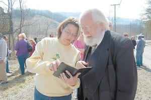 Misty Delph, of Neon, showed Rev. Wade M. Hughes on Tuesday where he had written her father Robert Griffith's name in his diary on March 9, 1976 after he had spent the day consoling family members who lost loved ones on that tragic day. Delph's mother, Madonna Griffith, was pregnant with her at the time of the explosion.