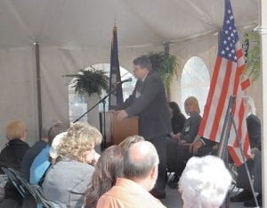 """L.M. """"Mike"""" Caudill, chief executive officer of Mountain Comprehensive Health Corporation, spoke to an audience of about 300 people at the dedication ceremony. MCHC and its subsidiary, Respiratory Clinics of Eastern Kentucky, submitted the application to the Kentucky Historical Society for the marker to honor those who died in the Scotia mine."""