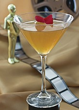 """Left: Academy Award nominee """"Crazy Heart"""" is the inspiration for this cocktail named Southern Heart. Right: """"District 9"""" is the inspiration for this cocktail named Alien Cooler. (AP Photos/Larry Crowe)"""