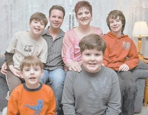 Keith and Kelli Gibson of Battle Creek, Mich., pose for a photo in their home with their sons, front left, Kolten, 6, and Caiden, 7 and in the back, Keifer, 9, left, and Connor, 11. All four boys have diff erent forms of autism. (AP Photo)