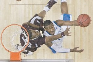 John Wall, right, shot over the defense of Mississippi State's Jarvis Varnado in the second half of Sunday's game. (AP Photo/Dave Martin)