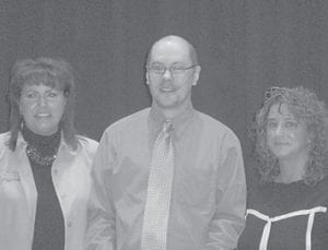 HONORED — Scotty Caudill, social service director of Letcher Manor Nursing & Rehabilitation, recently received the 2010 Elder Abuse Awareness Award for Nursing Home Staff . Pictured are (left to right) State Long-term Ombudsman Kimberly Baker, Caudill, and Kentucky River District Ombudsman Angie Smith.