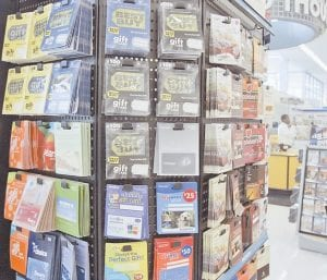 Gift cards for various retailers are off ered for sale at a supermarket in Omaha, Neb. The Federal Reserve issued new rules this week to protect Americans from getting stung by unexpected fees or restrictions on gift cards.(AP Photo)