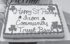 ST. PADDY'S DAY — Senior citizens at the Ermine Center enjoyed this St. Patrick's Day cake from Community Trust Bank.