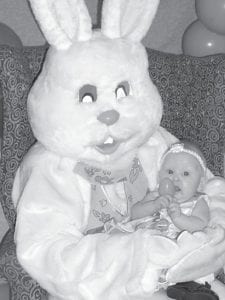 PRIZE EGG — Seely Baker, daughter of Glen and Goldie Baker of Isom, picked the prize egg on March 27 when the Letcher Manor Relay for Life Team hosted pictures with the Easter Bunny.