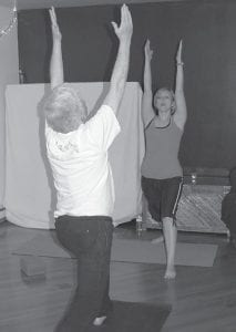 Heather Bates Vice instructed Rich Kirby during a yoga class in Whitesburg on March 30.