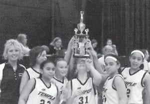 FAMILY TRADITION — Kathy Amburgey is pictured with the Temple Christian Crusaders Middle School girls' team, which won the regional Virginia Association of Christian Athletes tournament after an undefeated season. She is head coach of the team, and her husband is head coach of the boys' team.