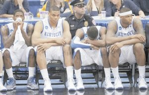 Kentucky's DeMarcus Cousins, right, and John Wall, second from right, reacted with teammates Daniel Orton and DeAndre Liggins during the last minutes of the final game in the East Regional of the NCAA college basketball tournament against West Virginia on Saturday in Syracuse, N.Y. West Virginia won, 73-66. This week, Cousins and Wall were selected as first-team members of the AP All-America team. (AP photo)