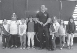 FIRE DEPARTMENT VISIT — Girl Scout Brownie Troop 1314 enjoyed a recent visit to the Jenkins Fire Department, where Jenkins Police Chief Adam Swindall talked to them about fire safety. The Brownies also learned about fire trucks and other firefighter equipment. They finished the day trying on firefighters' uniforms and learning about police equipment. Pictured are (left to right) Hannah Bates, Madison Pennepacker, Luna Combs, Amy Stamper, Adam Swindall, MyKaya Rose, Cammy Elswick, and Amanda Stamper.