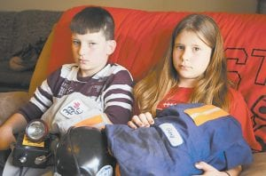 THEIR DAD WON'T BE COMING HOME — Trevor, 11, and Rabekka Quarles, 9, held their father's mining work clothes Tuesday at their home in Naoma, W.Va. On Monday Gary Quarles, 33, was killed in an explosion at Massey Energy's Upper Big Branch Coal Mine. (AP Photo/Jeff Gentner)