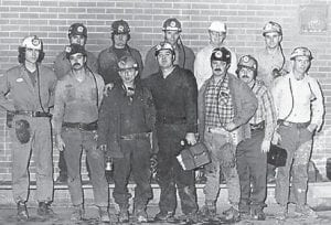 BETH-ELKHORN MINERS — The evening shift longwall crew at Beth-Elkhorn Mine #26 posed for this picture in 1977. From left to right (front row) are Jimmy Smith, Randall Branham, Foreman Joe Walker, Raymond Bentley, Richard Conley, Gary Mullins, Lavon Tackett, (back row) Robert Bentley, Danny Fleming, Jerry Rose, Assistant Superintendent Noll Davis, and Lamorn Quesenberry. Walker was the first longwall foreman at Beth-Elkhorn in 1971.