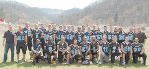 "FOR THE LOVE OF THE GAME — Members of the Letcher County Wolves, a new semi-professional football team, are (front row, left to right) Cortney ""Crazy"" Daniels, Nate Thompson, J.J. Montgomery, Anthony Hall, Tewayne Willis, Justin Wallace, Aaron Hall, Terry Tolson, Dustin Miller, Lee Shepherd, (standing) Assistant Coach Randy Johnson, Sheldon Francis, Cory Harris, Durrell Olinger, Trevor Buttrey, Chris Sexton, Mike Tolson, Dakota Brock, Tommy Gunn, Reid Mackin, Travis Yonts, Brandon Willis, Nick Cornett, James Guinn, Lenny Bates, Chico Adams, Dustin Gilley, James Potter, Matt Maggard, Shane Massey, Neil Richardson, Brandon Gentry, Head Coach Lennie Holbrook. (Photo by Sally Barto)"