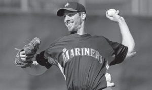 Seattle Mariners starting pitcher Cliff Lee threw a pitch during a simulated game in a baseball spring training workout in Peoria, Ariz., last month. Lee, the ace of the team's pitching staff , was placed on the 15-day disabled list Sunday with an abdominal strain, an expected move given the 2008 AL Cy Young Award winner's health troubles this spring. (AP Photo)