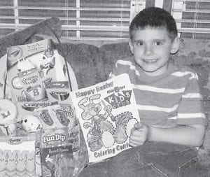 YOUNG ARTIST — Keegan Elkins won the Easter coloring contest held March 27 at Food City in the 6-8-year-old age group. He is the six-year-old son of Frank and Lisa Elkins of Deane. His grandparents are Julie Quillen of Deane and the late Vineyard Quillen. Keegan is a first-grade student at Beckham Bates Elementary School, where he participates in Pee-Wee Basketball.