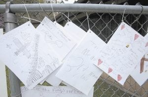 Letters, drawings and well-wishes by school children were hanging on a fence at a makeshift memorial in Whitesville, W.Va., on Tuesday (April 13) for 29 miners who died in the explosion at Massey Energy Co.'s Upper Big Branch mine in Montcoal, W.Va. a week ago Monday. Workers were able to remove the bodies of the last 9 miners from the mine earlier on Tuesday morning. (AP Photo/Amy Sancetta)