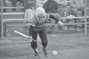 Jenkins senior Emily Walker led the way in the Lady Cavaliers' victory over Harlan County last week, going two for three at the plate with a pair of singles and three runs scored. She is seen here laying down a bunt in the victory, which improved the Lady Cavs to 13-2 on the season. (Photo by Chris Anderson)