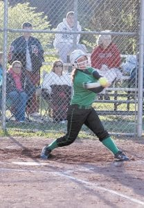 Alexis Watts connected her bat with the softball for a thirdinning double in the Lady Cavs' win over Harlan County.
